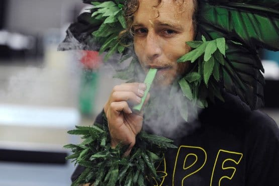 A man calling himself Henry Hemp inhales marijuana using a vaporizer pen at HempCon medical marijuana show, May 24, 2013 at the Los Angeles Convention Center. Thousands of marijuana enthusiasts gathered for the three-day event for exhibits of medical marijuana dispensaries, collectives, evaluation services, legal services and equipment and accessories. Under California state law, people suffering from chronic diseases have the right to grow, buy and use marijuana for medical purposes when recommended by a doctor. In 2003 the Medical Marijuana Protection Act, established an identification card system for medical marijuana patients. AFP PHOTO / ROBYN BECK