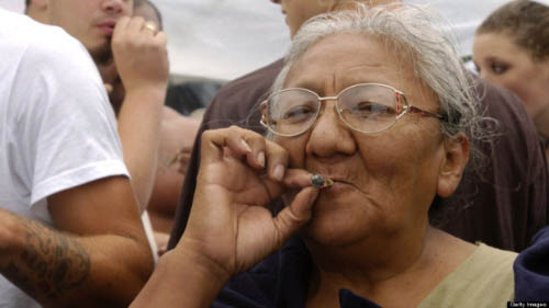 SEATTLE - AUGUST 21: An older woman smokes a marijuana joint at Seattle's Hempfest on August 21, 2004. More than 150,000 people were expected to attend Hempfest at Seattle's Myrtle Edwards Park on Seattle's waterfront on August 21-22, 2004. The event is billed as the world's largest drug-policy reform rally. Events included political speakers and dozens of bands and performers on six stages and over 20 organizations were present registering new voters. (Photo by Ron Wurzer/Getty Images)