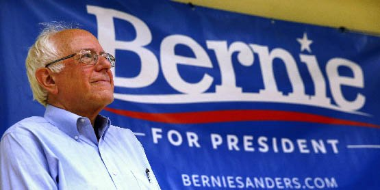 Democratic presidential candidate, Sen. Bernie Sanders, I-Vt., waits while he is introduced during a town hall meeting at Nashua Community College in Nashua, N.H., Saturday, June 27, 2015. (AP Photo/Michael Dwyer)