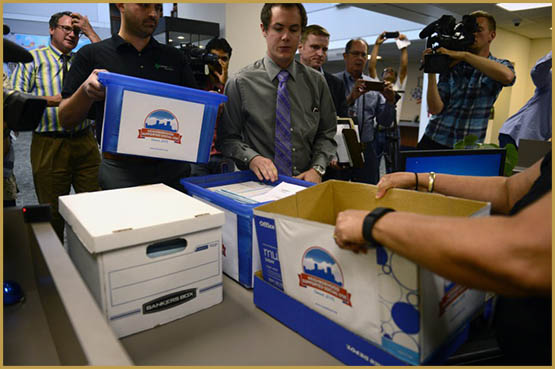 DENVER, CO - August 12, 2016: Marijuana activist Emmett Reistroffer and cannabis consultant Kayvan Khalatbari hand deliver more than 10,800 signatures for a public cannabis use ballot initiative to the Denver Elections officials. Backers of a Denver initiative that would allow adults to consume cannabis in regulated, neighborhood-approved consumption spaces submit a petition to city officials on Friday, August 12, 2016 with more than twice the number of voter signatures needed to qualify for the November ballot. (Photo by Vince Chandler / The Denver Post)